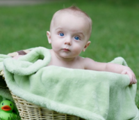 Baby in basket.PNG