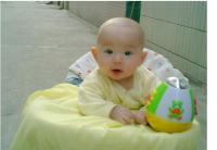 cute asian baby in yellow picture.jpg