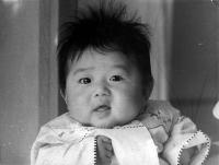 cute asian baby with a funny hairstyle.jpg