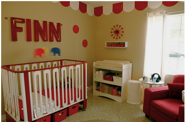 Fun baby decor for bright colored nursery in red and white.PNG