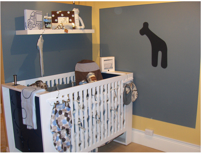 Baby boy nursery decor with chic styled crib.PNG