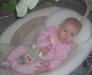 Baby girl chilling out on the bouncer