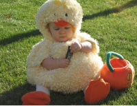 Toddler halloween costume with a chicken.PNG