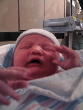 Newborn baby image still in red color.jpg