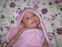 Cute baby girl wrapped in pink towel.PNG