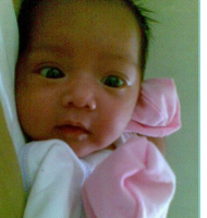 Newborn baby girl with beautiful big eyes.PNG