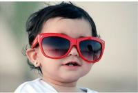 cute and cool looking baby girl with big red sunglasses.jpg