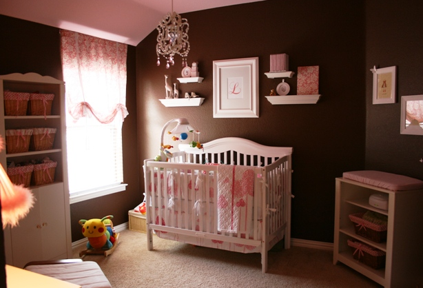 Baby girl nursery with dark chocoloate painted wall with white nursery furniture.PNG
