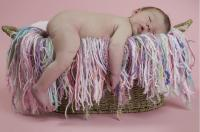 baby girl photo sleeping on backet.jpg