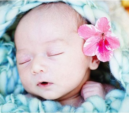 beautiful Asian baby picture with pink flower on the ear.jpg