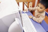 asian baby boy using the computer.jpg