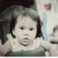serious looking asian baby girl photo.jpg