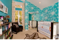 Boy nursery with bright blue wallpaper with sea creature theme.PNG