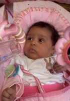 African American baby girl in pink swing.PNG