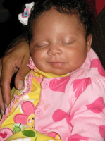 African American baby girl smiling while sleeping.PNG