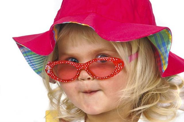 funny picture of a toddler wear a summer hat and sunglasses and is ready for the beach.jpg