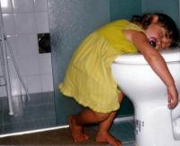 funny toddler girl in deep sleep on top of the toilet.jpg