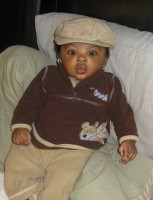 Fashional black baby boy with a very cute and cool outfit.PNG