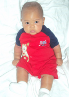 Picture of black baby boy with red and blue outfit.PNG