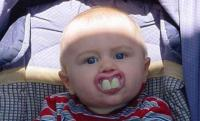 very funny baby with big front teeth.jpg