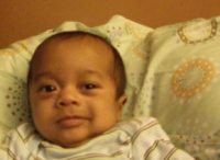 Sweet looking black baby boy image.PNG