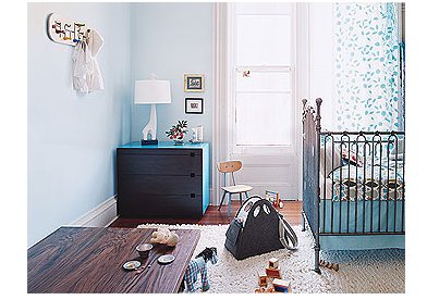 Modern boy nursery with bright blue and dark wood furniture.PNG