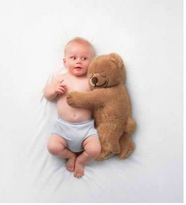 cute picture of baby being hug by a teddy bear.jpg