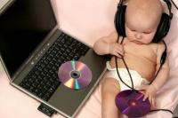dj baby wearing a big headphones.jpg