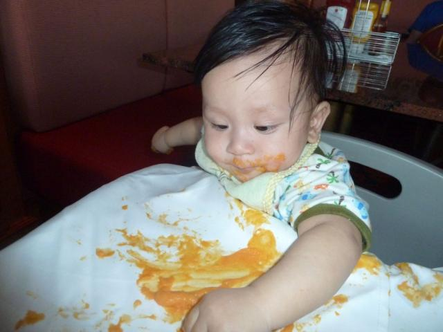 Darwin The Month Old Baby Eating Sweet Potato At The Garden Cafe - Baby on cruise ship