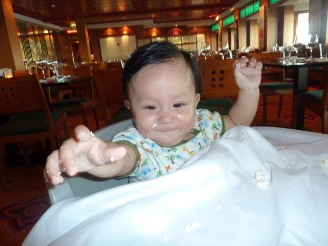 Darwin the 8 month old baby eating tofu at the Shabu Shabu Lotus Restaurant aboard the NCL Pearl.jpg
