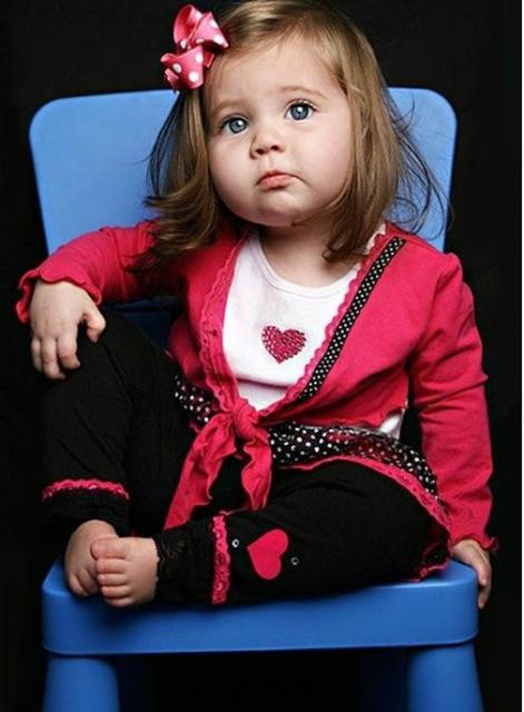 toddler fashion post sitting on a blue chair.jpg
