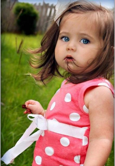 beautiful toddler photo with her wearing a pretty pink and white dress.jpg