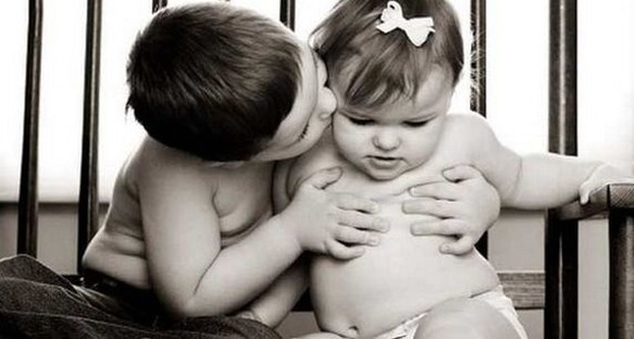 cute babies picture of a baby boy kissing a baby girl.jpg