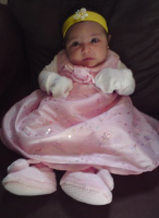 Baby girl in pink dress with yellow headband.PNG
