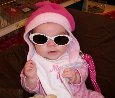 Baby girl in pink with cool white sunglasses.PNG