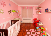 Fun modern baby girl nursery with bright colors.PNG