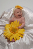 Baby girl post in bright yellow custome.PNG