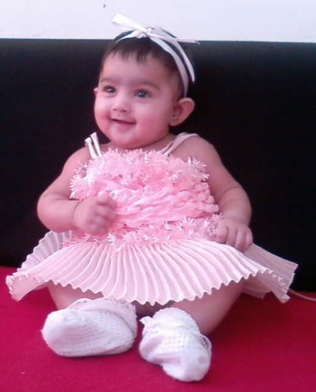 baby girl in pretty pink dress png