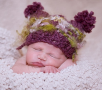 Baby with cute baby hat picture.PNG
