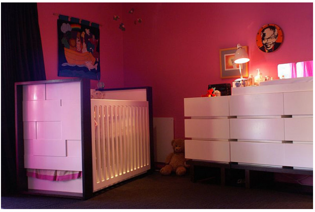 Bright pink and red modern nursery for baby girl.PNG