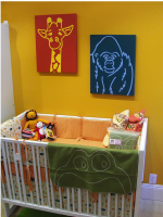 Nursery room decor with bright colors and animal themed.PNG