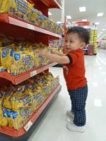 Darwin touches candy bars at Target.jpg