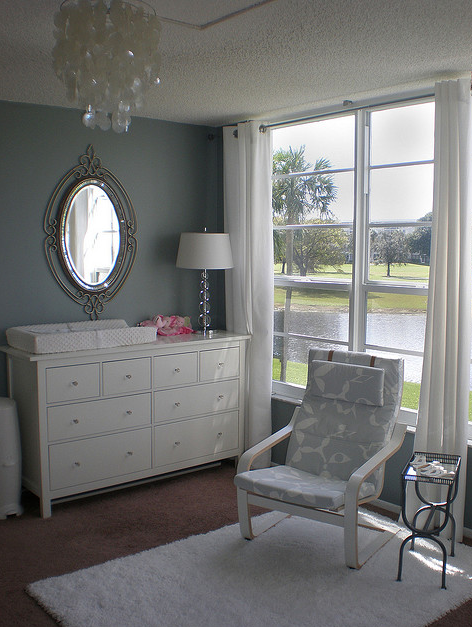 Elegant nursery with traditional mirror picture frames.PNG