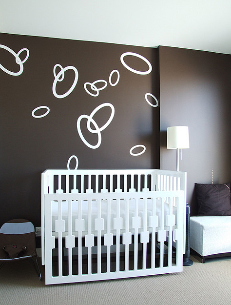 Stylish neutral nursery with white and chocolate colors.PNG