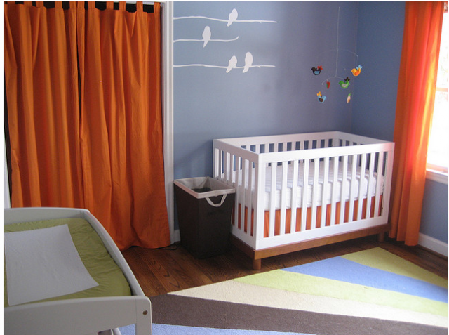 Stylish modern baby nursery decor in bright colors.PNG