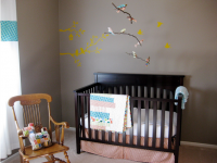 Simple and modern nursery with nature and bird themed with dark brown crib.PNG
