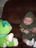 Baby boy friends with cute green teddy bear.PNG