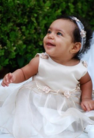 Pretty baby girl in cream baby gown.PNG