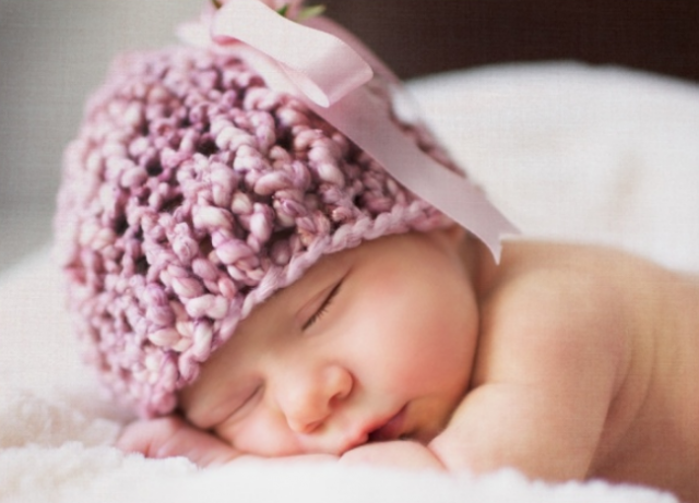 Sweet dream baby picture wearing a cute purple pink hat.PNG