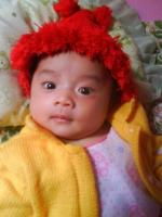 picture of asian with fun red hat looking at the camera.jpg